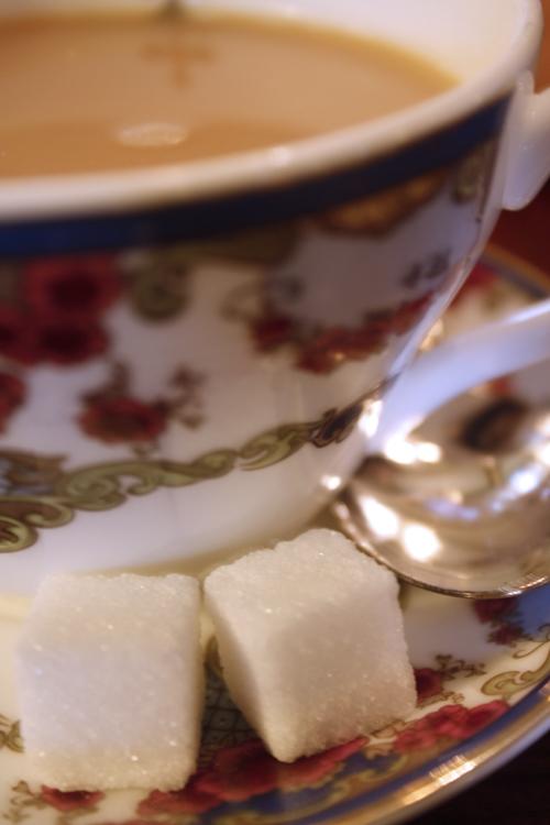 Teacup and sugar cubes